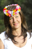 Middle aged woman flower in hair Royalty Free Stock Images
