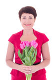 Middle aged woman with flowers isolated on white Royalty Free Stock Images