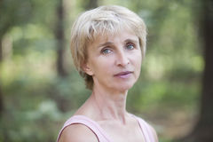 Middle Aged Woman In Forest. Closeup portrait of middle aged woman in forest Royalty Free Stock Images
