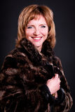 Middle-aged woman in a fur coat Stock Photo