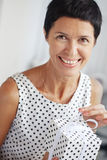 Middle aged woman with a gift Stock Images