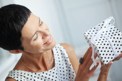 Middle aged woman with a gift Stock Photos