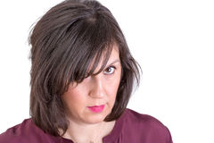 Middle Aged Woman Giving you very Analyitcal Look. She looks in to your eyes very analytically, are you sure you are telling the truth, she might be the boss royalty free stock photo