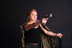 Middle-aged woman with a gun Stock Photos