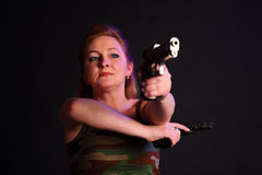 Middle-aged woman with a gun Royalty Free Stock Images