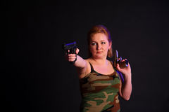 Middle-aged woman with a gun Stock Image