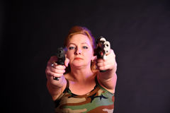 Middle-aged woman with a gun Royalty Free Stock Photos