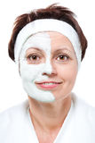 Middle aged woman with half beauty mask Royalty Free Stock Photo