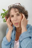 Middle-aged woman has headache Stock Images