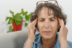 Middle-aged woman has headache Stock Photography