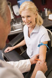Middle Aged Woman Having Blood Test Done Royalty Free Stock Photos