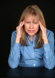 Middle aged woman with headache Stock Photo