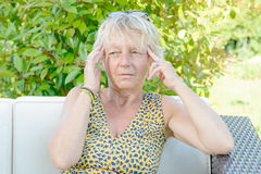 A middle-aged woman with a headache Royalty Free Stock Photos