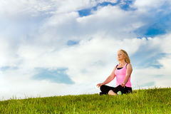 Middle-aged woman in her 40s meditating. For exercise outdoors Stock Photography