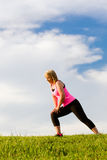 Middle-aged woman in her 40s stretching. For exercise outdoors Royalty Free Stock Images