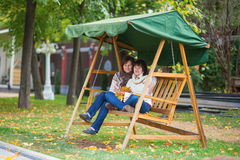 Middle aged woman with her adult daughter on a swing Stock Photography