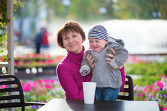 Middle aged woman and her little grandson Royalty Free Stock Photos