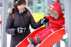 Middle aged woman and her little grandson at the playground Royalty Free Stock Photos