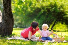 Middle aged woman and her little grandson in sunny park Royalty Free Stock Image