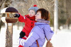 Middle aged woman and her little grandson at the winter park Stock Image