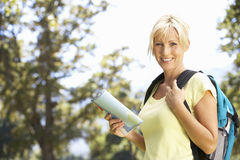 Middle Aged Woman Hiking Through Countryside Stock Image
