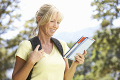 Middle Aged Woman Hiking Through Countryside Stock Photos