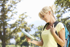 Middle Aged Woman Hiking Through Countryside Stock Photo
