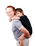 Middle aged woman holding little boy. On her back Royalty Free Stock Images