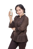 Middle aged woman holding milk bottle Stock Photo
