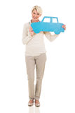 Middle aged woman holding paper car Royalty Free Stock Images