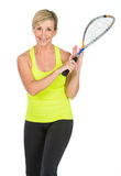 Middle aged woman holding squash racket Stock Images