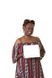 A middle aged woman holding a tablet Royalty Free Stock Image