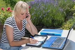 Middle aged woman in home office outdoors Royalty Free Stock Photography