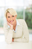 Middle aged woman home Stock Photography