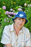 Middle-aged woman in jeans panama hat Stock Image