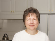 Middle Aged Woman in Kitchen Royalty Free Stock Photography