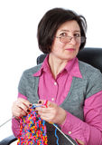 Middle-aged woman knit in my spare time. Royalty Free Stock Photography