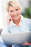 Middle aged woman laptop Royalty Free Stock Photography
