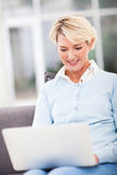 Middle aged woman laptop Royalty Free Stock Photo