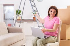 The middle-aged woman with laptop in home improvement concept. Middle-aged woman with laptop in home improvement concept stock photos