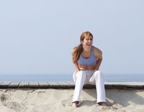 Middle aged woman laughing at the beach Royalty Free Stock Photography