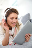 Middle-aged woman listening music with headphones Stock Photos