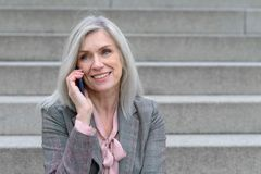 Middle-aged woman listening to a phone call royalty free stock photo