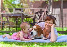 Middle aged woman with little girl. Middle aged women with a little girl in the garden stock image