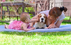 Middle aged woman with little girl. Middle aged women with a little girl in the garden royalty free stock images