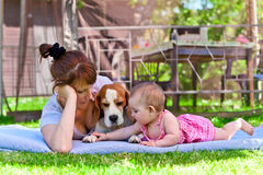 Middle aged woman with little girl. Middle aged women with a little girl in the garden stock photography