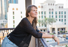 Middle aged woman looking happy. Royalty Free Stock Photography