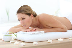 Middle-aged woman lying on massage bed relaxing Royalty Free Stock Photo