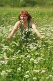 middle aged woman  on meadow Royalty Free Stock Image