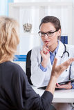 Middle aged woman on medical visit Royalty Free Stock Images